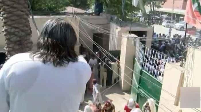 Watch: Hundreds gather outside Ali Amin Gandapur's residence for free rations