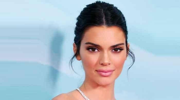 Kendall Jenner flashes toned abs while having dinner in Malibu
