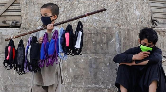 Already beset with financial woes, Peshawar's labourers say they can't afford face masks