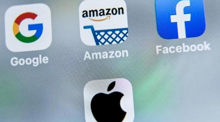 Apple, Facebook earn massive profits amid increased scrutiny