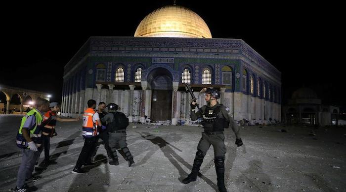 Israeli forces attack worshipers at Jerusalem's Al Aqsa Mosque, scores injured