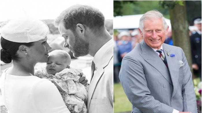Prince Charles has met Meghan's son Archie 'only twice,' palace aides claim