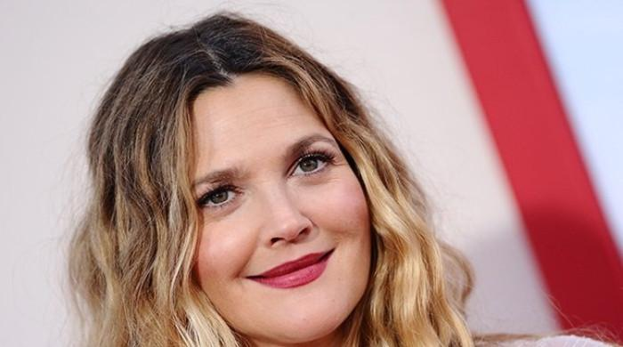 Drew Barrymore gets emotional as she details the meaning behind her tattoo