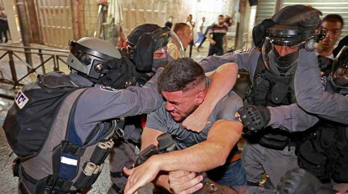 Sheikh Jarrah expulsions: Israeli police attack Palestinians at Jerusalem's Al-Aqsa compound