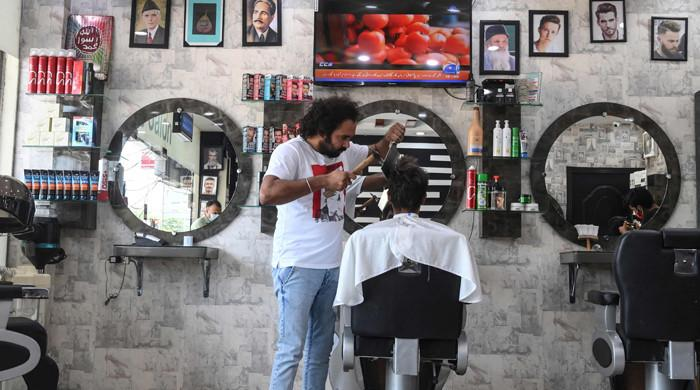 WATCH: Pakistani barber offers hair-raising cuts with cleavers, blowtorches