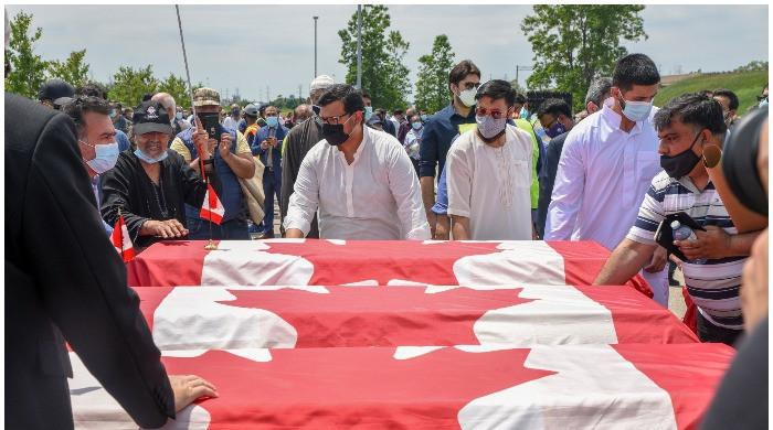 Farewell given to Muslim family killed in truck attack with coffins draped in Canadian flags