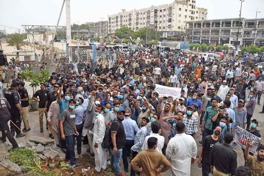 Shopkeepers hold a demonstration against the anti-encroachment operation at Rashid Minhas Road, Gulshan-e-Iqbal, Karachi, on June 15, 2021. — Online photo by Sabir Mazhar