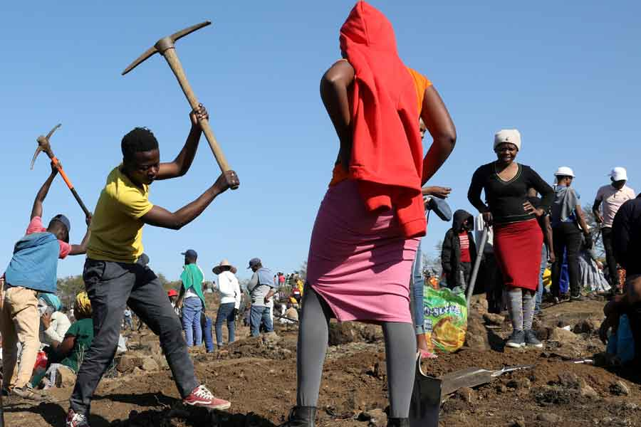 A person uses a pickaxe to dig as fortune seekers flock to the village after pictures and videos were shared on social media showing people celebrating after finding what they believe to be diamonds, in the village of KwaHlathi, outside Ladysmith, in KwaZulu-Natal province, South Africa, June 14, 2021. — Reueters/Siphiwe Sibeko