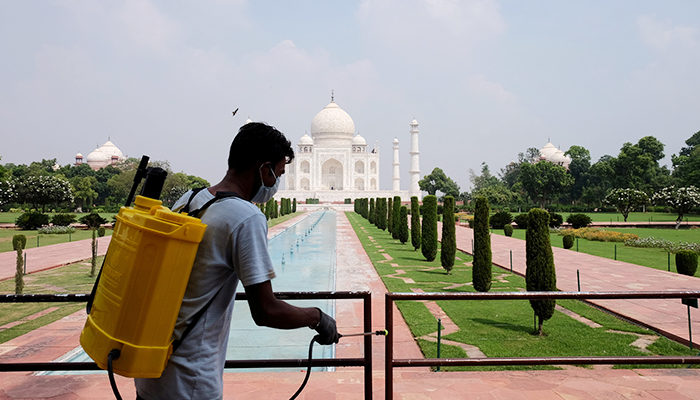 A man sanitizes railings in the premises of Taj Mahal after authorities reopened the monument to visitors, amidst the coronavirus disease (COVID-19) outbreak, in Agra, India, September 21, 2020. — Reuters/File