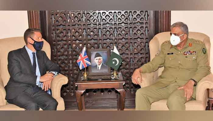 Chief of Army Staff General Qamar Javed Bajwa (R) in a meeting with British High Commissioner Dr Christian Turner, on June 18, 2021. — ISPR