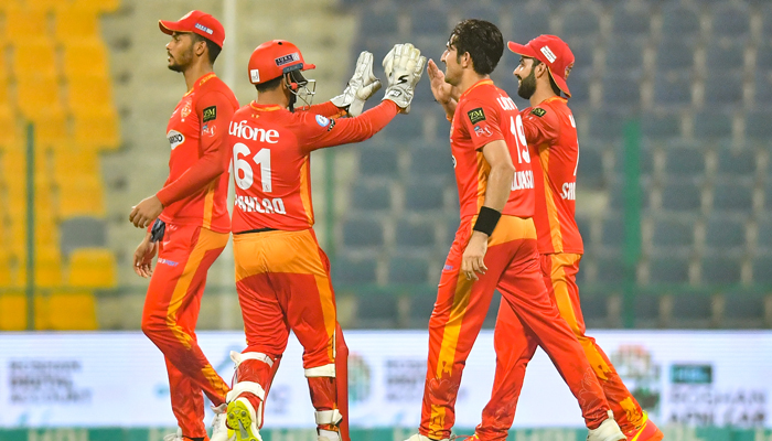 Islamabad United players celebrate after dismissing a Multan Sultans batsman at Sheikh Zayed Cricket Stadium in Abu Dhabi. Photo: PSL