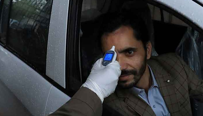 A Pakistani man gets his temperature checked. Photo: AFP