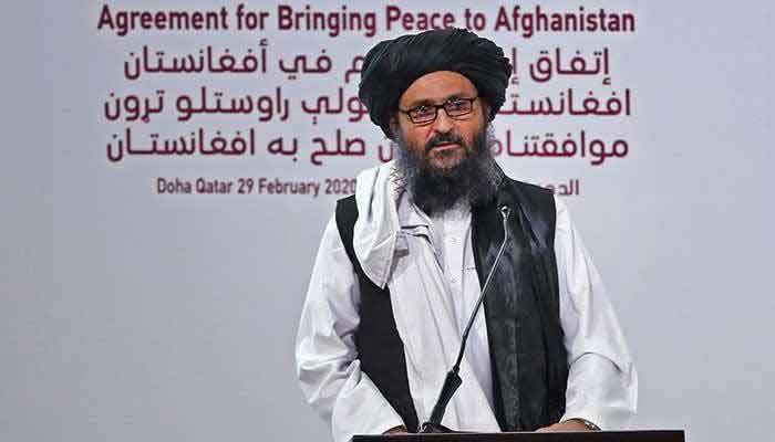 Mullah Abdul Ghani Baradar addressing an event in Doha, Qatar, on February 29, 2020, to oversee the signing of a landmark peace deal between America and the Taliban. — AFP