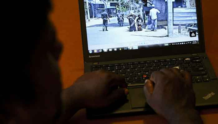 In this photo illustration taken on June 20, 2021 a user checks out a social media post on his laptop in Colombo after Sri Lankas military launched an investigation after social media posts showed soldiers humiliating minority Muslims by forcing them to kneel on the streets during a coronavirus lockdown. — AFP/Ishara S Kodikara
