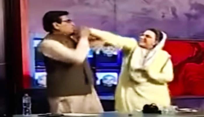 Special Advisor to Chief Minister (SACM) on Information Firdous Ashiq Awancan be seen hitting PPP MNA Abdul Qadir Mandokhel during arguing during a TV show. — Twitter/File
