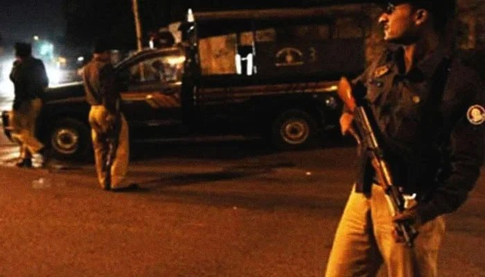 A police officer can be seen holding a rifle. — File photo
