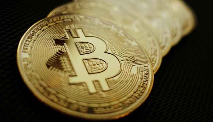 Representations of the Bitcoin cryptocurrency are seen in this illustration picture taken June 7, 2021. — Reuters/Edgar Su/Illustration