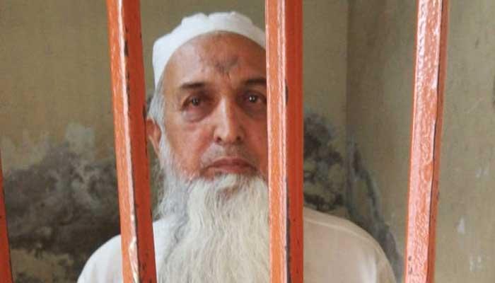 Accused Mufti Aziz-ur-Rehman behind bars. Picture Punjab IG Inam Ghani.