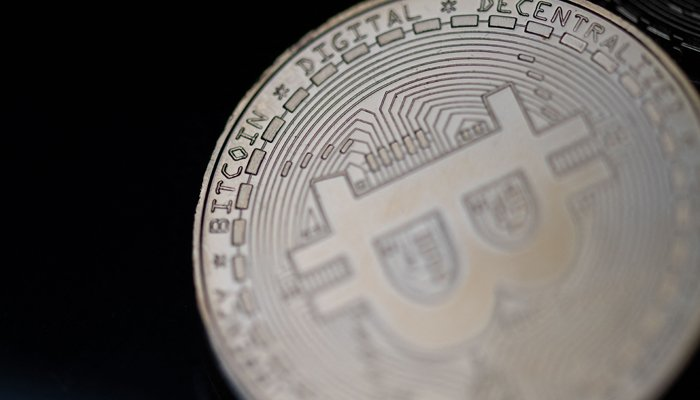 This file photo taken on April 26, 2021 in Paris shows a physical imitation of the Bitcoin crypto currency. US and European stocks rallied June 21, 2021. — AFP/File