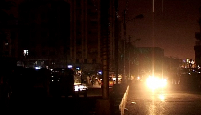 A file photo shows darkened streets due to load-shedding in Karachis Gulistan-e-Jauhar area.