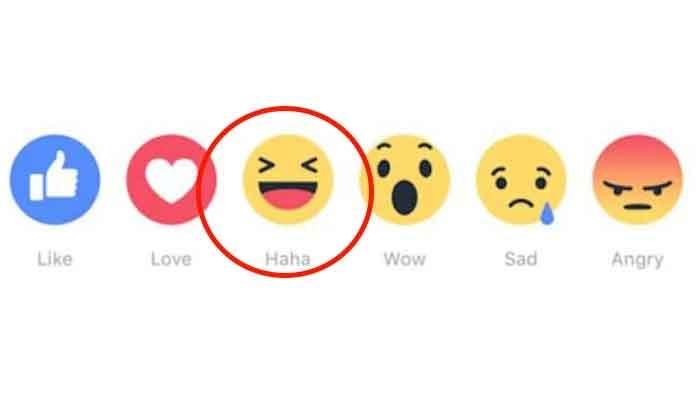 The haha emoji as seen underneath posts by people on Facebook.
