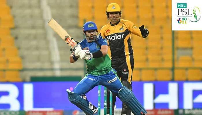 Multan Sultans batsman Mohammad Rizwan and Peshawar Zalmis Kamran Akmal look towards the ball at Abu Dhabis Sheikh Zayed Stadium. Photo:PSL