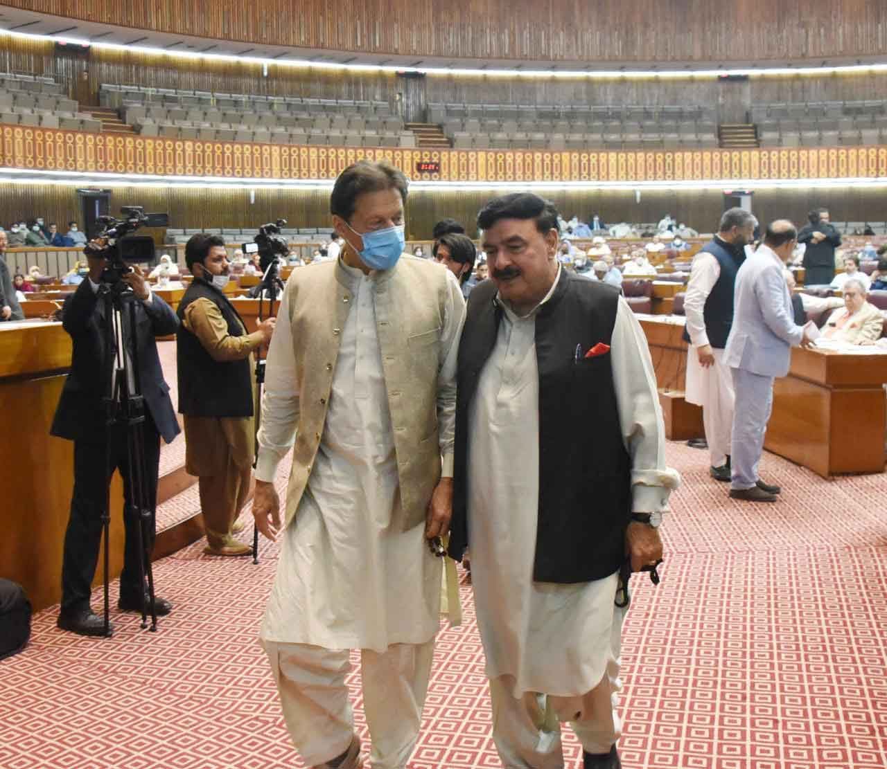 Prime Minister Imran Khan and Minister for Interior Sheikh Rasheed Ahmed leaving the National Assembly after the session was adjourned.
