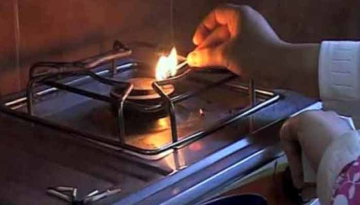A person tries to light a stove, unsuccessfully. Photo: File