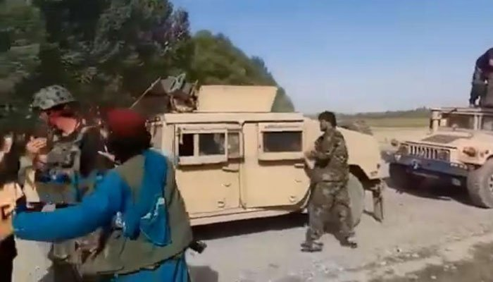 Taliban seize US forces vehicles and weapons from surrendering Afghan troops
