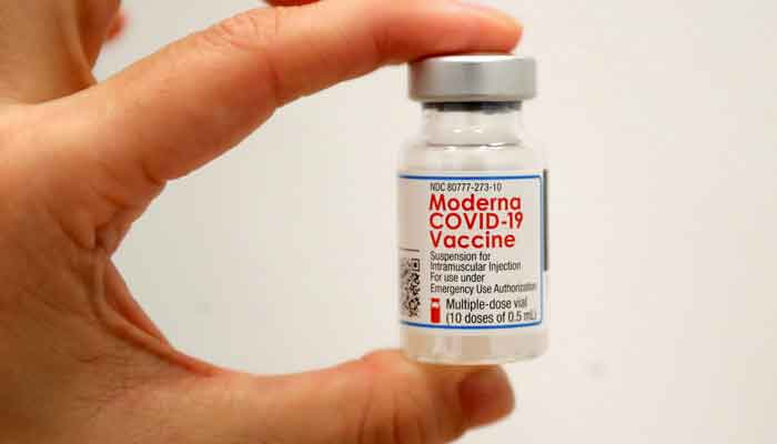 A healthcare worker holds a vial of the Moderna COVID-19 vaccine at a pop-up vaccination site operated by SOMOS Community Care during the coronavirus disease (COVID-19) pandemic in Manhattan in New York City, New York, US, January 29, 2021. — Reuters/Mike Segar