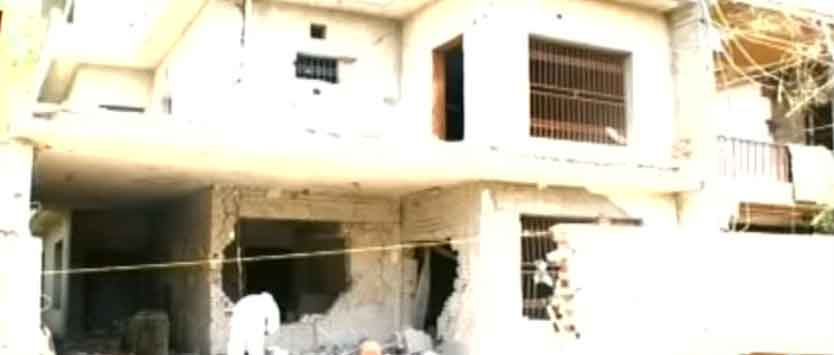 The house whose gate and front facade were completely destroyed in the attack. — Geo News