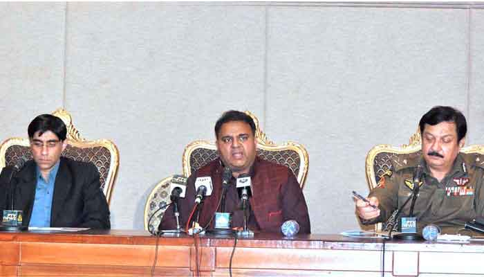 Federal Minister for Information and Broadcasting Chaudhary Fawad Hussain (C) along with Special Assistant to the Prime Minister on National Security Division and Strategic Policy Planning Dr. Moeed W. Yusuf (L) and Inspector General of Police Punjab Inam Ghani brief the media at the PM Secretariat, in Islamabad, on July 4, 2021. — APP photo by Saleem Rana