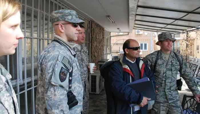 The author (2nd R) photographed with American troops at the Bagram base, in Kabul, Afghanistan, January 2012. — Photo provided by author