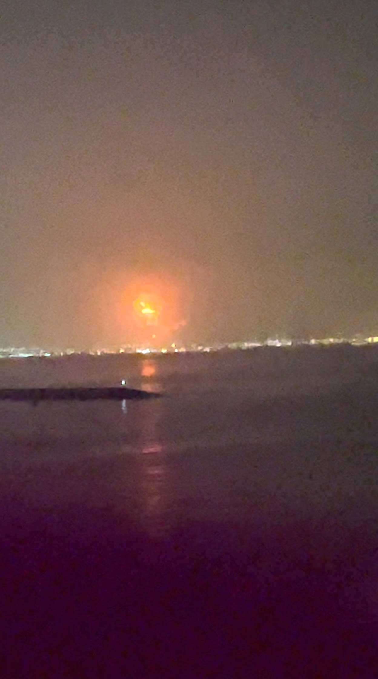 Fire caused by an explosion is seen at Dubais Jebel Ali Port in Dubai, United Arab Emirates, July 7, 2021, in this still image taken from video obtained from social media.-via REUTERS