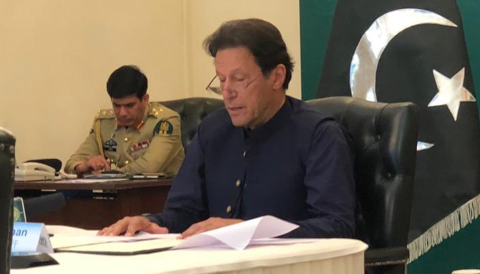 A picture of Prime Minister Imran Khan reading a dossier. Photo: Twitter