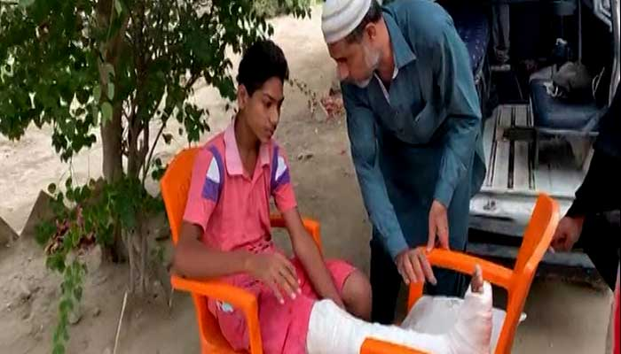 Student brought to a exam centre in Karachi via ambulance.
