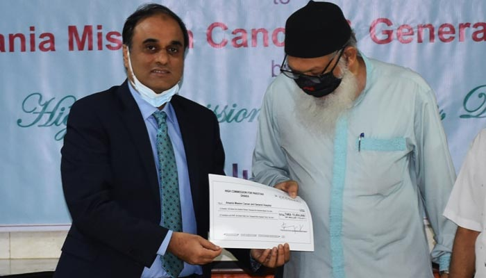 Pakistans High Commissioner Imran Ahmed Siddiqui (left) handing over financial assistance to President Ahsania Mission Kazi Rafiqul Alam. — Supplied