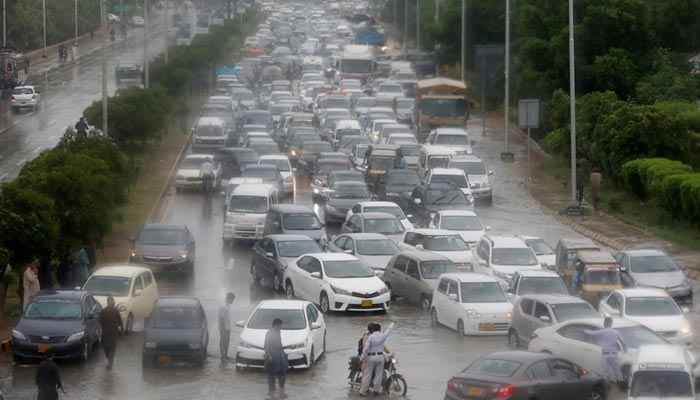 A general view shows traffic on a Karachi road during the monsoon rain on August 25, 2020. — Reuters/File