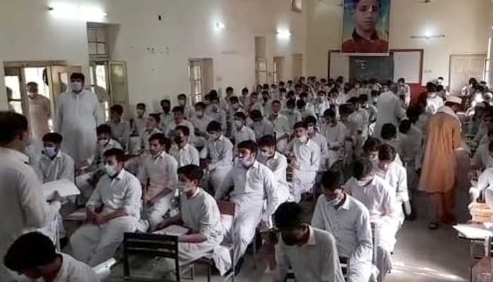 Students waiting for paper to start as board exams commence in KP. Photo Daniyal Aziz.