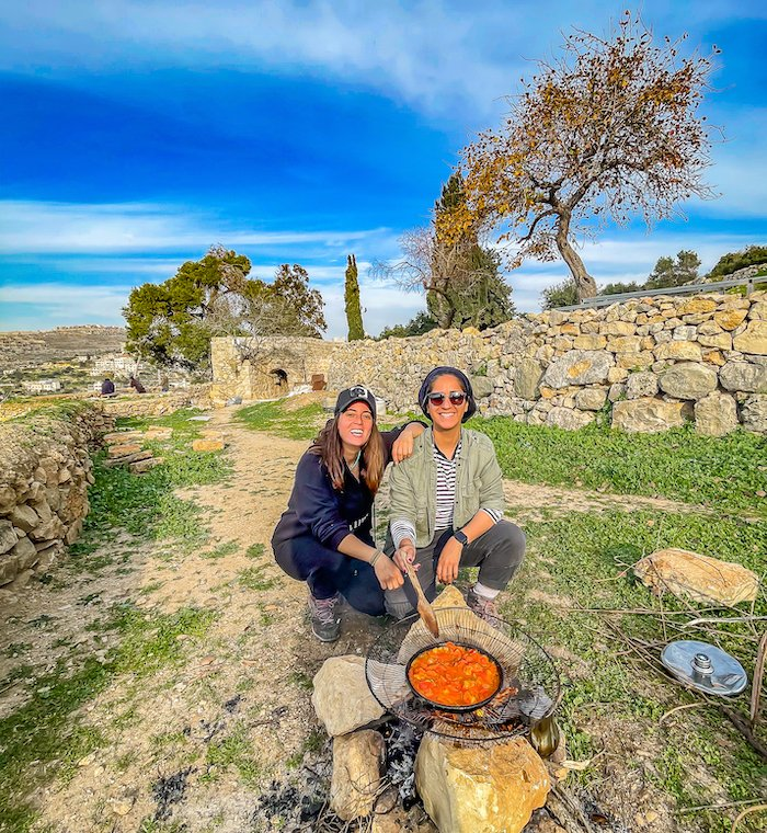 Travel bloggers Malak Hassan and Bisan Alhajhasan at Ein Qinya, a small village that lies seven kilometers northwest of Ramallah. Photo: Courtesy Ahlan Palestine