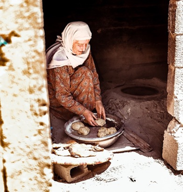 Umm Mohammad, a mother of 12 children resides in Jaba' village in Jenin. She holds tight onto her tradition by wearing her traditional dress and is one of those true warriors who safeguard her land, heritage, and future. Photo: Courtesy Ahlan Palestine