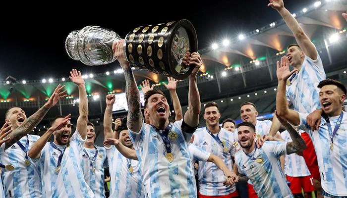 Copa America 2021 - Final - Brazil v Argentina - Estadio Maracana, Rio de Janeiro, Brazil - July 10, 2021 Argentinas Lionel Messi and teammates celebrate winning the Copa America with the trophy. — Reuters