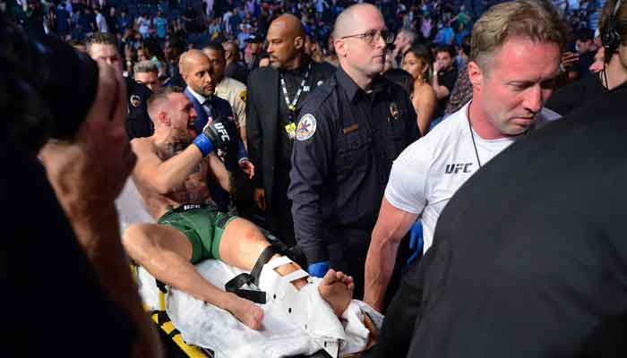 Conor McGregor is carried off a stretcher following an injury suffered against Dustin Poirier during UFC 264 at T-Mobile Arena, Las Vegas, Nevada, USA, July 10, 2021. — Reuters via Gary A. Vasque/USA TODAY Sports