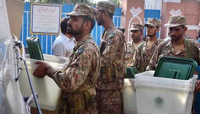 Pak Army troops transfer the election related material to different polling stations in connection with AJK Legislative Assembly elections in this APP file photo.