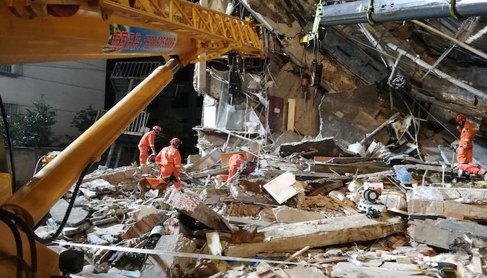 Rescue workers work at the site where a hotel building collapsed in Suzhou, Jiangsu province, China July 13, 2021. China Daily via REUTERS