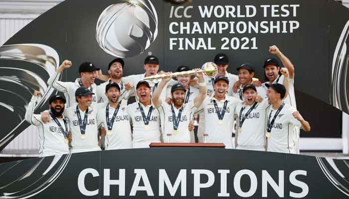 New Zealands Kane Williamson celebrates with the trophy and teammates after winning the final to the ICC World Test Championship, Rose Bowl, Southampton, Britain, June 23, 2021. — Action Images via Reuters/John Sibley