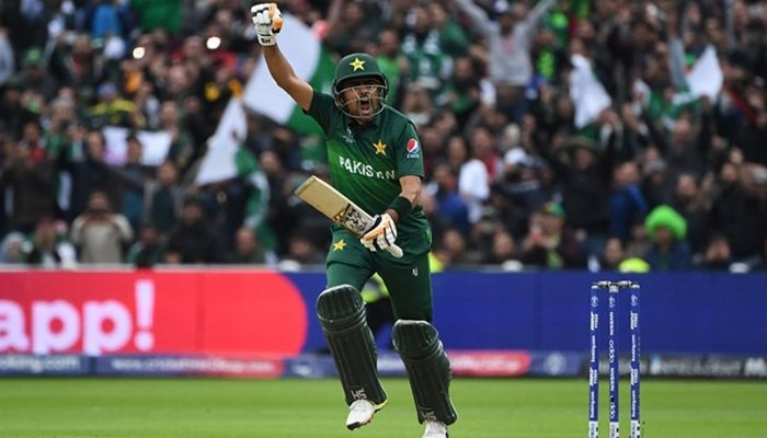 Pakistan captain Babar Azam pumps his fist in joy after scoring a century against New Zealand in the ICC World Cup 2019. Photo: AFP
