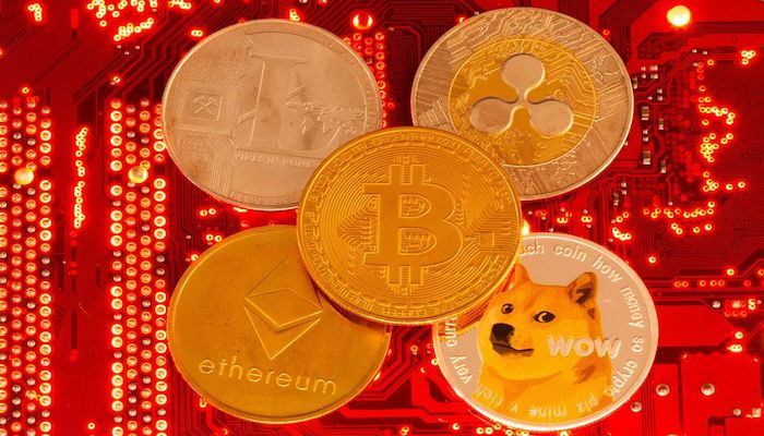Representations of cryptocurrencies Bitcoin, Ethereum, DogeCoin, Ripple, Litecoin are placed on PC motherboard in this illustration taken, June 29, 2021. Photo: Reuters
