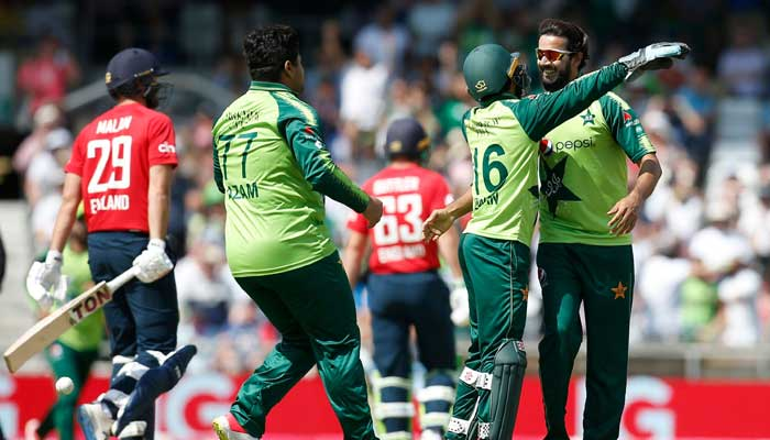 Pakistans Mohammad Rizwan congratulates Imad Wasim after he took wicket during the second T20 against England.