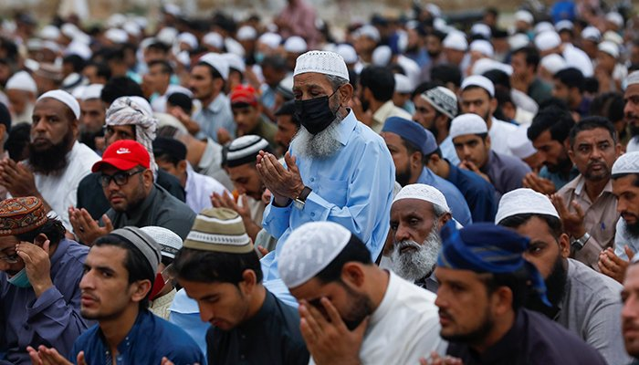 Muslims attend Eid ul Adha prayers at a playground, as the outbreak of the coronavirus disease (COVID-19) continues, in Karachi, Pakistan July 21, 2021. — Reuters